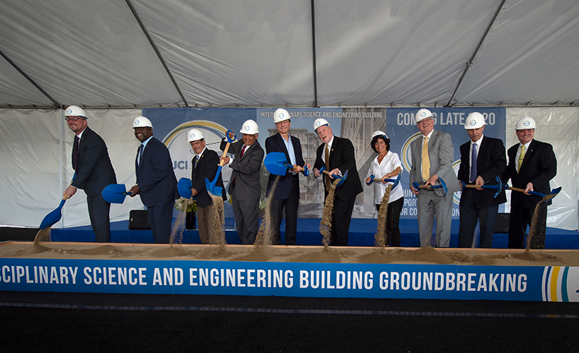 Digging in at the groundbreaking ceremony are, from left: Brian Pratt, Greg Washington, Enrique Lavernia, Pramod Khargonekar, Henry Samueli, Chancellor Howard Gillman, Meredith Michaels, Ken Janda, Marios Papaefthymiou and Brian Hervey.