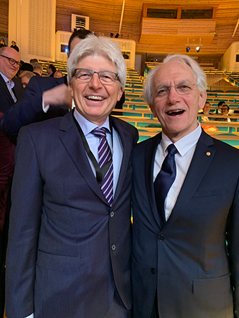 "Juhasz, UCI professor of biomedical engineering and ophthalmology (left), and Nobel winner Mourou are pictured in Stockholm before the Nobel Prize ceremony, which Juhasz called ""magnificent."""