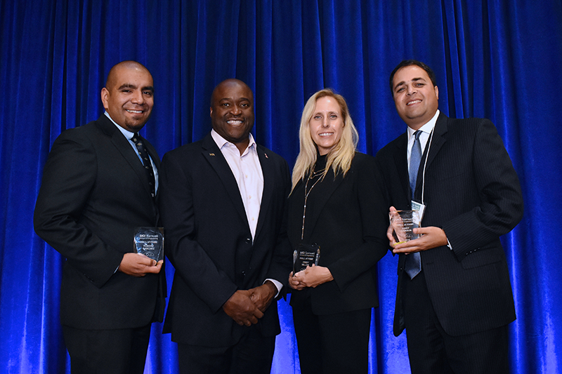 This year's Samueli School Hall of Fame inductees include, from left, Robert Sanchez, Cindy Miller and Hany Haroun (with Dean Gregory Washington, second from left). Not pictured: Daryoosh Vakhshoori. Photo: Carlos Puma