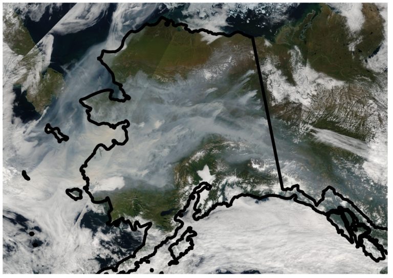 A satellite image of Alaska captured in August 2005 shows the extent of smoke coverage from wildfires in the state's boreal forests. The blazes are likely to become large in exceptionally hot and dry conditions and when there's a high percentage of black spruce trees in the affected areas – key factors in a new predictive model developed by UCI scientists. NASA