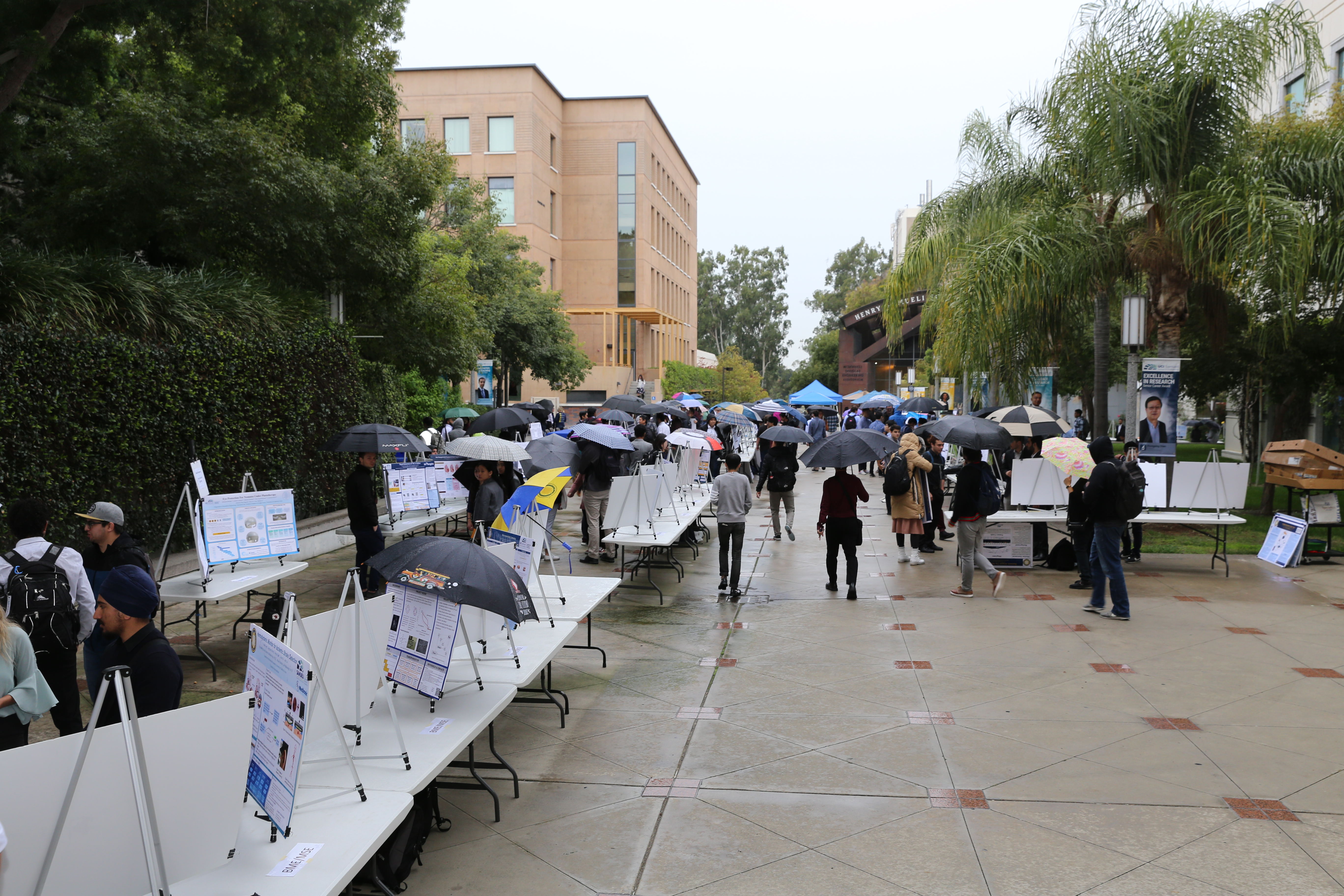 Students brave the rain at the Fall Design Review