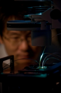 UCI project scientist Don-Ku Kang observes the IC 3D technology, which can rapidly detect bacteria in blood samples.