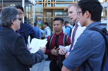 Engineering students talk with recruiter at EngiTech career fair