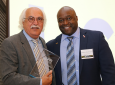 Sorooshian holds an engraved plaque from Dean Gregory Washington during his tribute dinner.