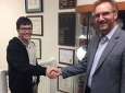 Dat Huynh (left) is congratulated by MAE Chair Ken Mease