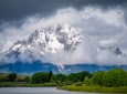 Wyoming's Mount Moran emerges from thick clouds shortly after a heavy rainstorm, with the Snake River in the foreground. The peak is part of the Teton Range rising around 6,000 feet (1800m). Snowmelt from this area is a major source of water for the five states through which the Snake River passes. Amir AghaKouchak / UCI