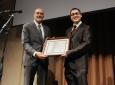 Robert Tkach presents award to Salvatore Campione