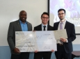 FWMAV team members accept their first-place check for $10,000. From left: Engineering Dean Gregory Washington, Patrick Zhu and Nathan Cabezut (not pictured, team member Bao Pham).