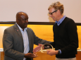 Samueli School Dean Gregory Washington congratulates Innovator of the Year Professor David Reinkensmeyer