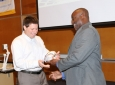 Elliot Botvinick (left) receives Innovator of the Year award from Dean Washington