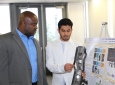 Abdullah Alotaibi explains his project involving the structural behavior of thin-walled steel tubes to Samueli School Dean Gregory Washington.