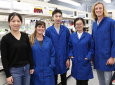 Han Li (left), UCI assistant professor of chemical & biomolecular engineering, and students (from left) Sarah Maxel, Edward King, Linyue Zhang and William Black have developed an artificial, computationally derived cofactor. Debbie Morales / UCI