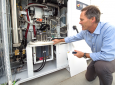 Jack Brouwer, UCI associate professor of mechanical & aerospace engineering and civil & environmental engineering, explains the workings of an electrolyzer, a key component of the power-to-gas system. The device uses renewable electricity to split water i