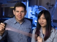 Alon Gorodetsky, UCI associate professor of chemical & biomolecular engineering, and Erica Leung, a UCI graduate student in that department, have invented a new material that can trap or release heat as desired. Steve Zylius / UCI