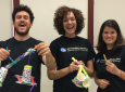 From left: Engineering grad students Eric Schwartz, Katherine Acord and Jennifer Schuler host a workshop at the Rancho Santa Margarita Public Library, teaching participants how to make robot arms out of everyday items.