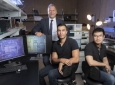 The potentially revolutionary wireless transceiver – which can operate in a frequency range over 100 gigahertz – was developed by (from left) Payam Heydari, director of UCI's Nanoscale Communication Integrated Circuits Labs and professor of electrical engineering & computer science; and lab members Hossein Mohammadnezhad, who earned a Ph.D. in electrical engineering & computer science this year, and Huan Wang, a doctoral student in the same department. Steve Zylius / UCI
