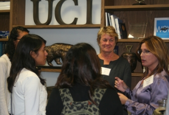 ICS professor Debra Richardson and mentor Sarah Drislane speak with students at the event