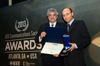 Hamid Jafarkhani (right) receives IEEE Sumner Award