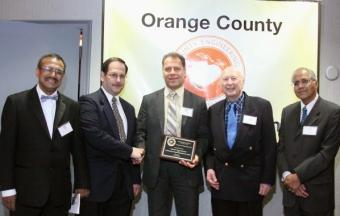 Payam Heydari (center) with officers of the Orange County Engineering Council