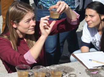 Assistant Professor Kristen Davis judges the water filtration competition