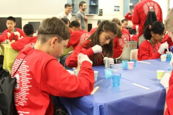 Middle schoolers make a 3-D mold of their thumbs at UCI's Rapidtech