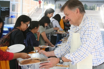 John LaRue, associate dean for undergraduate affairs, passes out pancakes at last year's Dean's Breakfast.