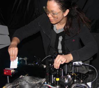 Michelle Digman angles a laser beam into a special microscope to excite the flourescent molecules in tissue