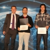 Associate Professor Syed Jafar (center) and graduate student Arash Gholamidavoodi (right) accept a Best Paper Award at IEEE GLOBECOM 2014