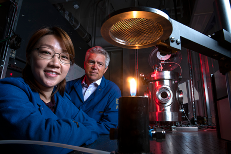 Mechanical and aerospace engineering project scientist Yu-Chien (Alice) Chien and Derek Dunn Rankin work to better understand the chemistry of flame, which in turn can help scientists explore ways to reduce pollution. Steve Zylius / UCI