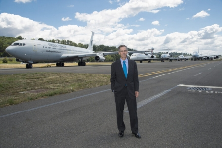 """""""In my work at Boeing, I saw firsthand how a kid from an underserved community can dramatically change the life of an entire family overnight when they get their first paycheck in a technology field,"""" says John Tracy, Ph.D. '87, shown here at the aerospace giant's 2016 centennial celebration in Seattle. Courtesy of John Tracy"""