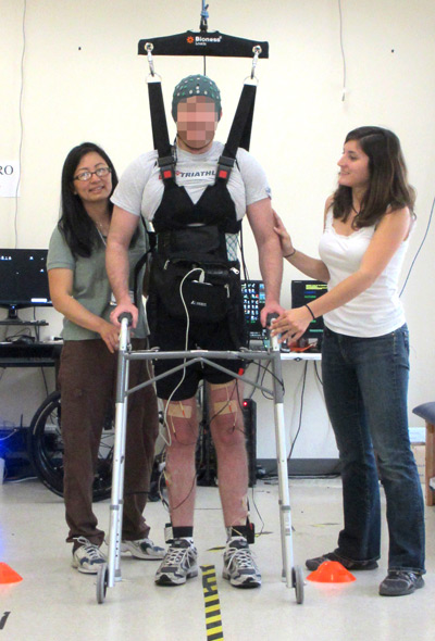 A man whose legs had been paralyzed for five years walks along a 12-foot course using UCI-developed technology that lets the brain bypass the spinal cord to send messages to the legs.